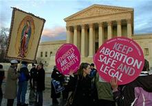 <p>Abortion rights demonstrators (R) share the plaza with pro-life demonstrators (L) in front of the US Supreme Court to mark the 35th anniversary of Roe vs Wade, the landmark legislation which allowed abortion rights, during a rally in Washington January 22, 2008. REUTERS/Mike Theiler</p>