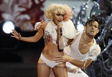 "<p>Lady Gaga performs ""Paparazzi"" at the 2009 MTV Video Music Awards in New York, September 13, 2009. REUTERS/Gary Hershorn</p>"