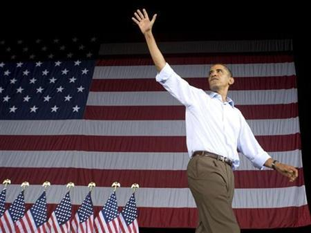 U.S. President Barack Obama waves as he attends an AFL-CIO Labor Day picnic at Coney Island in Cincinnati September 7, 2009. REUTERS/Larry Downing