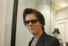 <p>Kevin Bacon walks out of the gift shop in the lobby of newly renovated Ford's Theater in Washington February 9, 2009. REUTERS/Molly Riley</p>