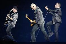 <p>Lead singer Bono (R) of the rock band U2 performs with guitarist The Edge (L) and bass guitarist Adam Clayton (C) during the first of two concerts at Giants Stadium in East Rutherford, New Jersey, September 23, 2009. REUTERS/Gary Hershorn</p>