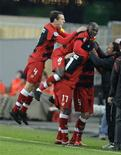<p>Sebastien Squillaci, do Sevilla , celebra gol em vitória sobre o Stuttgart por 3 x 1. REUTERS/Michael Dalder</p>