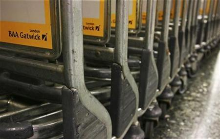 Luggage trolleys bearing the BAA logo are seen at Gatwick Airport in this August 20, 2008 file photograph. REUTERS/Luke MacGregor/Files