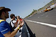 <p>Pierre-Luc Gelineau (L) cheers his brother Mathieu, who is driving the Esteban solar car manufactured by the Ecole Polytechnique de Montreal of Canada, during the time trial held at the Hidden Valley race track in Darwin as part of the 2009 Global Green Challenge October 24, 2009. REUTERS/Regi Varghese</p>