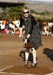 <p>Madonna turns the soil to lay the foundation of a multi-million dollar girls' school she is building in Chinkota, outside Lilongewe in Malawi October 26, 2009. REUTERS/Siphiwe Sibeko</p>