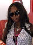 <p>Foto de archivo de la supermodelo Naomi Campbell en el garaje del equipo Ferrari de Fórmula Uno durante el Gran Premio de Turquía, jun 7 2009. Una compañía de marketing de perfumes inició una demanda contra Naomi Campbell por incumplimiento de contrato, argumentando que la modelo retuvo millones de dólares en ganancias que le debía por una fragancia que la empresa ayudó a desarrollar. REUTERS/Kerim Okten/Pool</p>