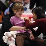 <p>Six-year-old Shea McAlpine reacts while receiving the H1N1 influenza vaccination in Ottawa October 26, 2009. Health care workers across the country began administrating H1N1 influenza vaccine shots on Monday. REUTERS/Chris Wattie</p>