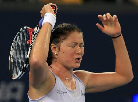 World number one Dinara Safina of Russia reacts after losing a point during her second round match against Zhang Shuai of China at the China Open tennis tournament in Beijing October 5, 2009. Safina will warm up for the Australian Open at January's Brisbane International, organisers said on Friday.    REUTERS/David Gray/Files