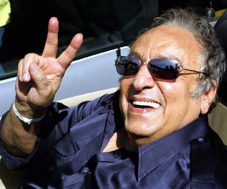 WBC's president Jose Sulaiman smiles as he greets fans during a tour in Cancun City, Mexico in this January 2006 file photo. The World Boxing Council will no longer rely on a promoter's word or handshake in recouping sanctioning fees and has established a committee aimed at pursuing delinquents and ''greedy boys''. REUTERS/Henry Romero