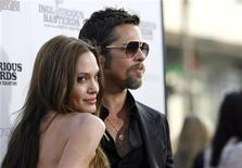 """<p>Cast member Brad Pitt and his partner actress Angelina Jolie pose at the premiere of """"Inglourious Basterds"""" at Grauman's Chinese theatre in Hollywood, California August 10, 2009. REUTERS/Mario Anzuoni</p>"""