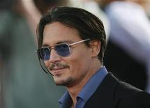 """<p>Cast member Johnny Depp poses at the premiere of the movie """"Public Enemies"""" at the Mann Village theatre in Westwood, California in this June 23, 2009 file photo. REUTERS/Mario Anzuoni</p>"""