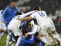 <p>Jogadores da Grécia comemoram classificação para a Copa do Mundo de 2010, em Donetsk, na Ucrânia. REUTERS/Gleb Garanich</p>