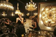 <p>Visitors and assistants look at exhibits at the opening of the Millionaire Fair, the fair of luxury goods and services which opened in Moscow October 27, 2006. REUTERS/Alexander Natruskin</p>