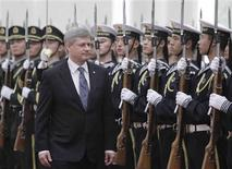<p>Prime Minister Stephen Harper inspects honor guards during a welcome ceremony at the Great Hall of the People in Beijing December 3, 2009. REUTERS/Grace Liang</p>