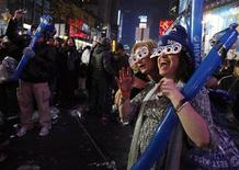 <p>Revelers sing during New Year's celebrations in New York's Times Square January 1, 2010. REUTERS/Jessica Rinaldi</p>