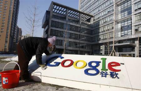 A woman cleans the logo of Google China outside the company headquarters in Beijing January 14, 2010. Google Inc enters a second week of high stakes brinkmanship with China's government, amid speculation the firm has decided to pull out of the world's biggest Internet market over cyber-spying concerns. REUTERS/Jason Lee