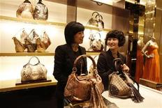 <p>Staff members of the new Gucci flagship store in Shanghai chat as they wait for customers on its opening day June 6, 2009. China will become the world's biggest luxury market in five to seven years as consumers see incomes grow along with sustained appetite for high-end brands despite the recent economic downturn, a survey said on Thursday. REUTERS/Nir Elias</p>