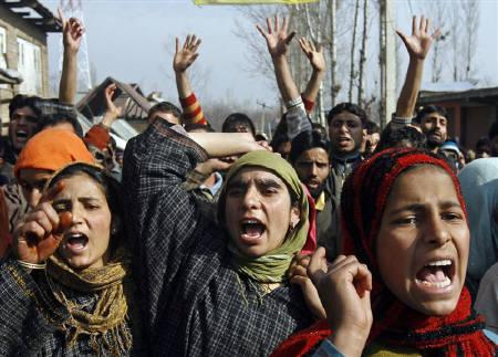 Women shout ''we want freedom'' during a protest after the death of Mushtaq Ahmad, a Kashmiri Muslim villager, in Shadi Marg, 55 km south of Srinagar January 24, 2010. Thousands of people shouting ''we want freedom'' took to the streets in Kashmir on Sunday, accusing the Indian army of killing a villager. REUTERS/Fayaz Kabli