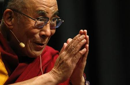 Tibetan spiritual leader the Dalai Lama gives his blessing to the audience during a talk in Melbourne December 10, 2009. REUTERS/Mick Tsikas