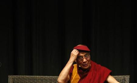 Tibetan spiritual leader the Dalai Lama gestures during a talk to an audience in Melbourne in this December 10, 2009 file photo. REUTERS/Mick Tsikas
