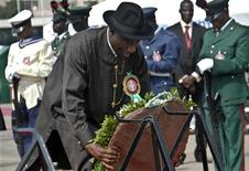 <p>Nigeria's Vice President Goodluck Jonathan lays a wreath during an Army Remembrance Day ceremony in the capital of Abuja Janaury 15, 2010. REUTERS/Afolabi Sotunde</p>