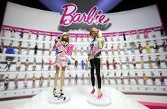 <p>Mattel's newly-introduced News Anchor Barbie (L) and Computer Engineer Barbie are shown in front of a display of career-doll Barbies at the Toy Fair in New York February 12, 2010. REUTERS/Jeff Zelevansky</p>