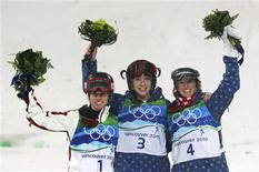 <p>Gold medalist Hannah Kearney (C) of the U.S., silver medalist Jennifer Heil of Canada (L) and bronze medalist Shannon Bahrke of the U.S. celebrate during the flower ceremony after the women's freestyle skiing moguls final on Cypress Mountain at the Vancouver 2010 Winter Olympics February 13, 2010. REUTERS/Mark Blinch</p>