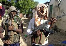 <p>Members of an Islamist group during armed combat training in a back street in Mogadishu, June 27, 2008. REUTERS/Ismail Taxta</p>