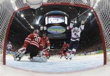 <p>Brian Rafalski of the U.S. celebrates his goal against Canada in front of goalie Martin Brodeur in first period of their hockey game at the Vancouver 2010 Winter Olympics, February 21, 2010. REUTERS/Bruce Bennett/Pool</p>
