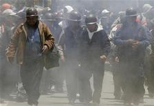 <p>Independent miners march amid smoke from dynamites they threw during a rally in the centre of La Paz February 6, 2007. REUTERS/David Mercado</p>