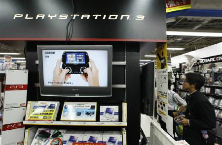 A boy plays Sony's playstation 3 at an electronic store in Tokyo October 30, 2009. REUTERS/Kim Kyung-Hoon/Files