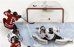 <p>Canada's Jarome Iginla (12) scores a goal on Germany's goaltender Thomas Greiss during the second period of their men's play-offs qualification ice hockey game at the Vancouver 2010 Winter Olympics February 23, 2010. REUTERS/Hans Deryk</p>