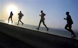 <p>Joggers are seen along a waterfront in a file photo. REUTERS/Arko Data</p>