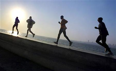 Joggers are seen along a waterfront in a file photo. REUTERS/Arko Data