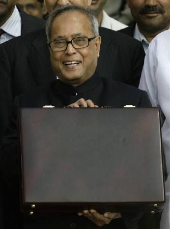 Finance Minister Pranab Mukherjee smiles as he leaves his office to present the federal budget 2010/11 in New Delhi in this February 2010 file photo. REUTERS/Vijay Mathur