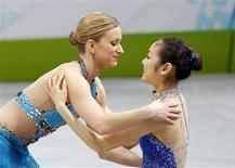 <p>Bronze medallist Canada's Joannie Rochette (L) hugs gold medallist South Korea's Kim Yu-Na during the medals ceremony for the women's figure skating event at the Vancouver 2010 Winter Olympics, February 25, 2010. REUTERS/Gary Hershorn</p>