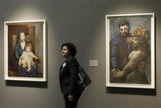 <p>A visitor walks by Pablo Picasso's Portrait of Mrs Rosenberg and her Daughter (R), 1918, and The Village Dance, 1922, displayed at State Pushkin Museum of Fine Arts in Moscow February 25, 2010. REUTERS/Denis Sinyakov</p>