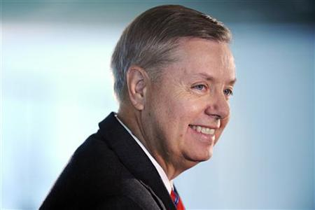 Senator Lindsey Graham (R-SC) smiles during an interview at the Newseum in Washington, October 1, 2009. REUTERS/Jonathan Ernst