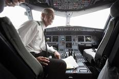 <p>Capt. Chesley 'Sully' Sullenberger goes through his pre-flight routine before piloting a flight to North Carolina from LaGuardia Airport in New York October 1, 2009. REUTERS/Seth Wenig/Pool</p>