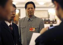 <p>Wang Guoxin, a painter and impersonator of the late Chinese leader Mao Zedong, poses for picture inside the Great Hall of the People during the opening ceremony of the National People's Congress (NPC) in Beijing March 5, 2010. REUTERS/Nir Elias</p>