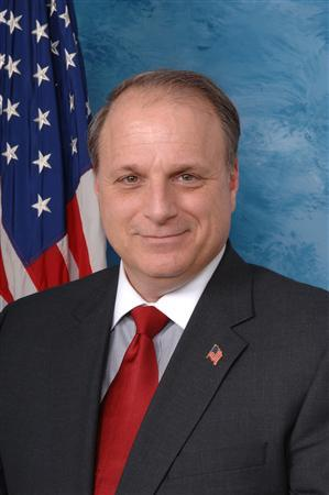 Democratic Representative Eric Massa poses in this 2009 official photo. Massa announced his resignation on March 5, 2010, saying an ethics investigation into alleged misconduct toward a male staff member would tear his family and staff apart. REUTERS/massa.house.gov/Handout