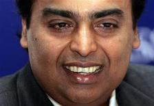 "<p>Mukesh Ambani, chairman of India's biggest private sector company, Reliance Industries, smiles during a conference on ""Partnership between Business and Law"" in New Delhi, August 21, 2006. REUTERS/Kamal Kishore</p>"