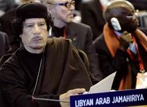 <p>Libya's leader Muammar Gaddafi attends the Food and Agriculture Organisation (FAO) Food Security Summit in Rome, November 16, 2009. REUTERS/Filippo Monteforte/Pool</p>