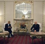 """<p>Президент США Барак Обама встречается с президентом Афганистана Хамидом Карзаем в Кабуле 28 марта 2010 года. Экстремистское движение """"Талибан"""" в среду подвергло президента США Барака Обаму насмешкам за то, что он посетил Афганистан ночью, как """"вор"""". REUTERS/Ahmad Masood</p>"""