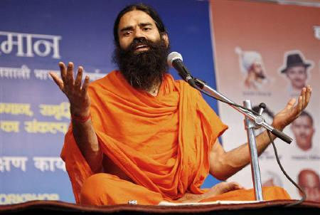 Yoga guru Swami Ramdev speaks during a yoga camp in Haridwar April 8, 2010.  REUTERS/Jitendra Prakash