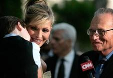 <p>Larry King interviews his wife Shawn Southwick and their son Cannon at a party to celebrate King's 20 years with CNN in Beverly Hills, October 6, 2005. REUTERS/Mario Anzuoni</p>