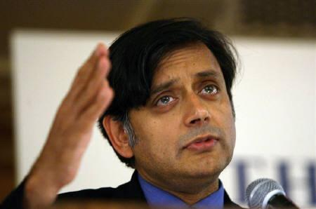 A file photo of Shashi Tharoor as he speaks at a meeting in Singapore July 27, 2006. Tharoor, among the country's few reformist politicians, resigned on Sunday over allegations of corruption in winning a cricket league franchise, as the government tries to pass reform bills in parliament. REUTERS/Luis Enrique Ascui/Files