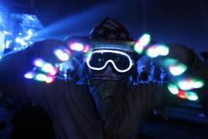 "<p>A concert-goer dances during the performance by ""Tiesto"" at the Coachella Music Festival in Indio, California April 17, 2010. REUTERS/Mario Anzuoni</p>"