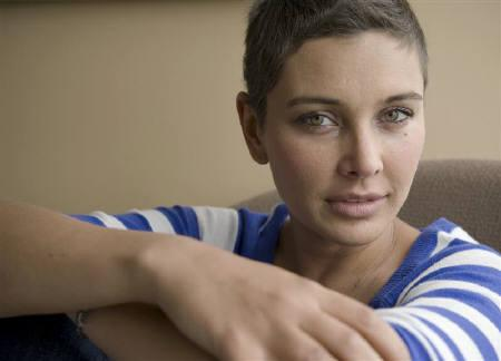 Canadian Bollywood actress Lisa Ray poses for Reuters in the Hollywood area of Los Angeles, California April 21, 2010. Ten months after being diagnosed with a rare form of cancer, Ray says she is cancer free, has enjoyed being bald, and is ready to embrace her second home, India, with new vigour. REUTERS/Gus Ruelas