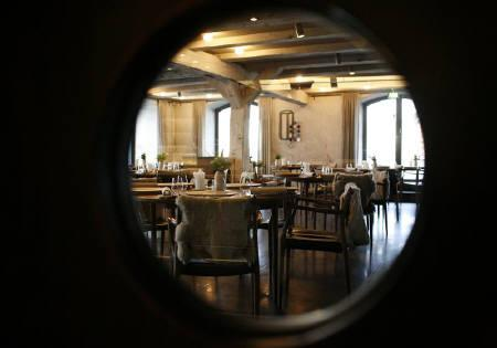 The Noma restaurant run by chef Rene Redzepi is seen in Copenhagen in this picture taken through a window on December 12, 2009. Denmark's Noma won one of the restaurant world's highest accolades this week with a menu that champions innovative Nordic cuisine.  REUTERS/Christian Charisius/Files